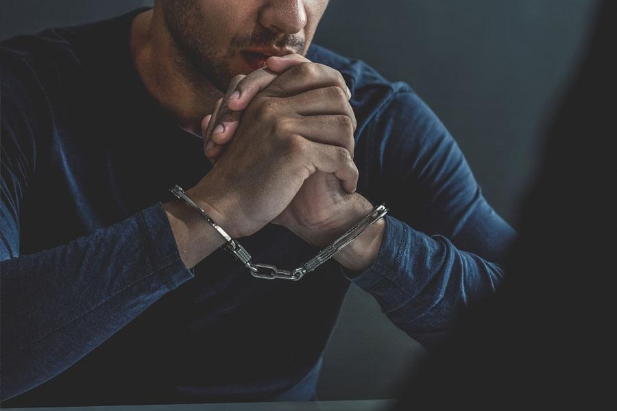 Crime Insurance - White Collar Crime in Handcuffs