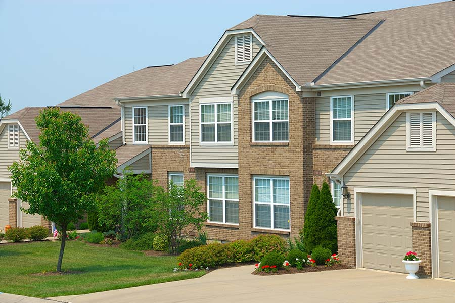 Condo Insurance - Row Of Two Story Condo Homes In The Suburbs
